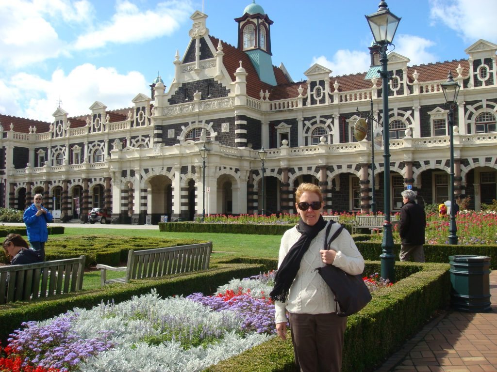 The beautiful gardens outside Dunedin Railway Station and Pam of course.