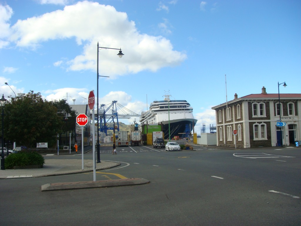 Port Chambers, the Vollendam berthed at the end of the Main Street.