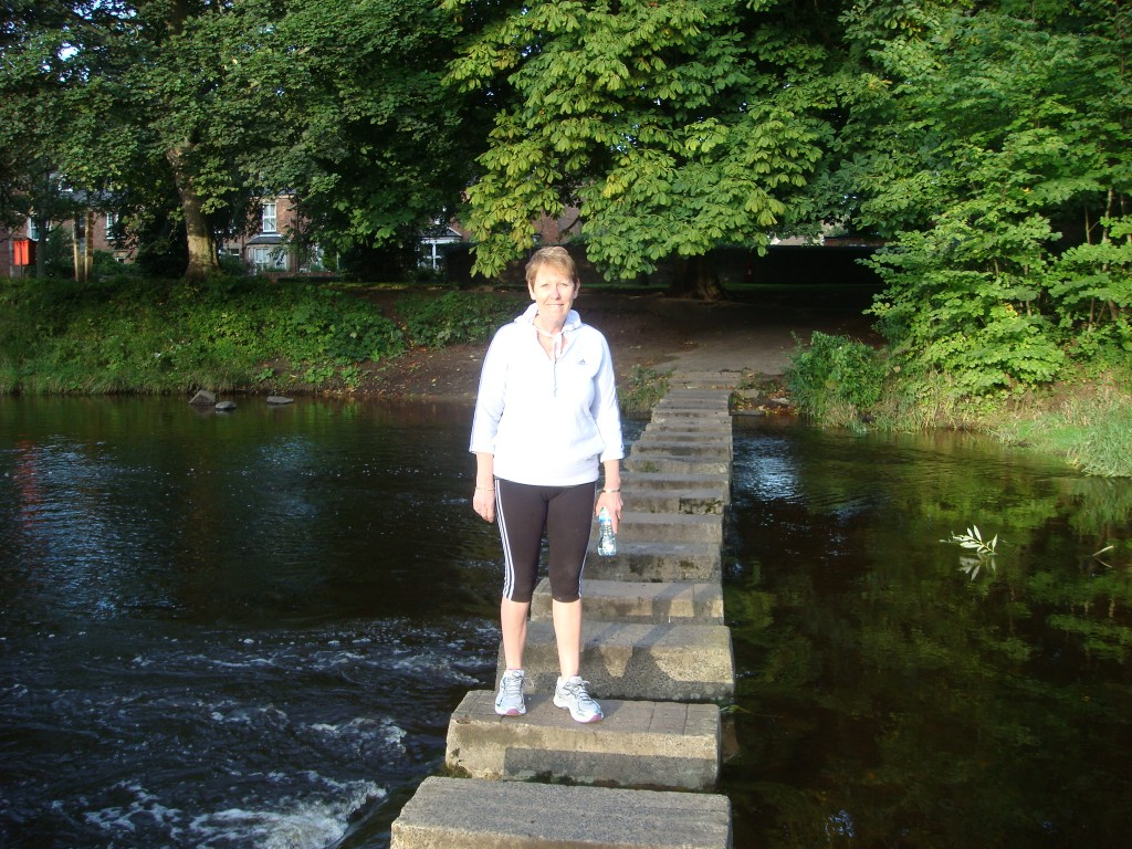 Pam walking across the Wansbeck River, Morpeth.  2011