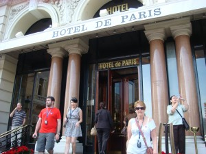 Pam moves past the Ferrari and the Bentley to stand in front of the Hotel De Paris. Monaco.  2011