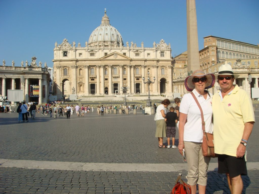 Pam and Michael in Saint Peter's Square, The Basilica in the background, The Papal City.  2011