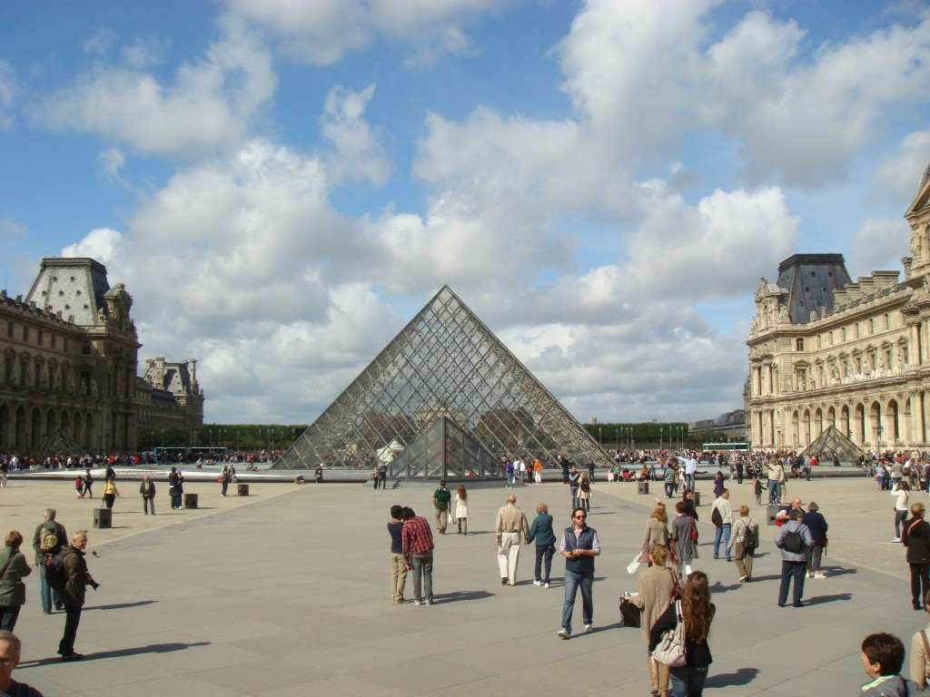 Walking the courtyard of the Louvre, Paris.  2011