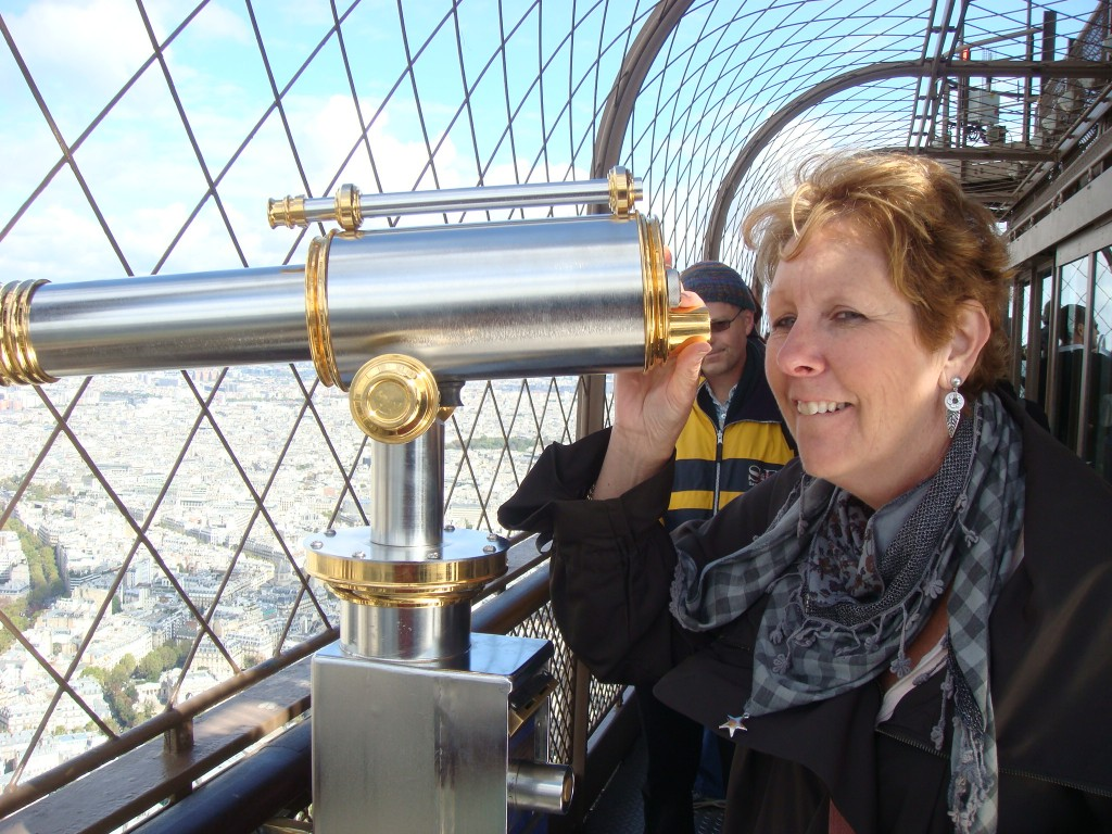 Pam enjoys the view from the top deck of the Eiffel Tower, Paris.  2011