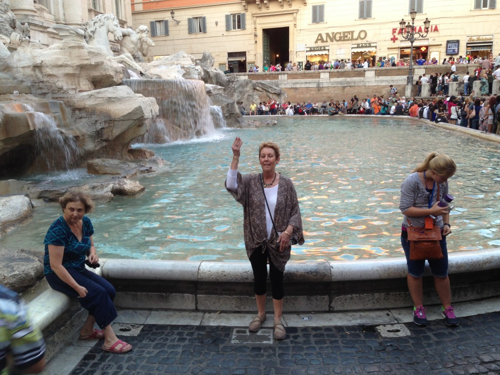 Pam throwing her 3 coins in the Trevi Fountain, Rome.  2013