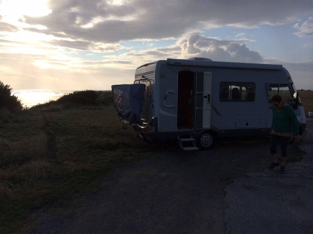 Our camper car at Longues-Sur-Mur, the Mulberry at Arromanches in the distance. France. 2014