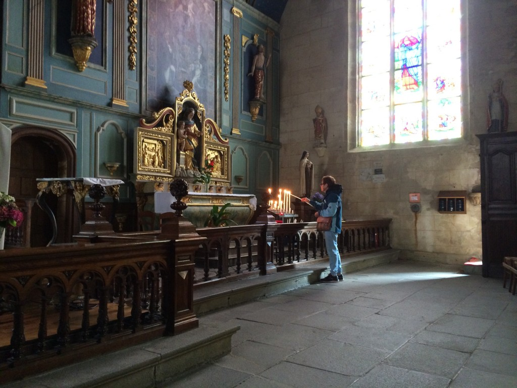 Pam lights another candle, The Notre Dame, Locronan, Brittany.  2014