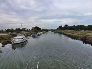 The tree lined Midi Canal has disappeared as we approach the Etang, France.  2014