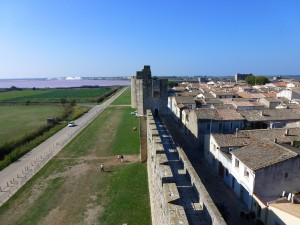 The walls of Aigues-Morts, the pink hue of the waters are from the salt beds out in the Etang, France.  2014