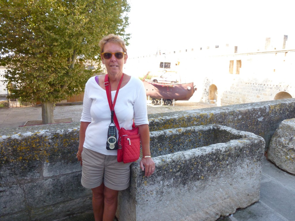 Pam's looking for the hot tap on the 14th century bath tub, Aigues-Morts, France.  2014
