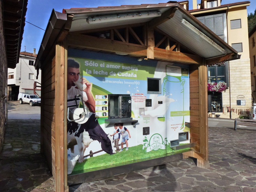 Milk vending machine. Bring your own container, put a euro in the slot and get your fresh milk.  Potes,  Spain.  2014