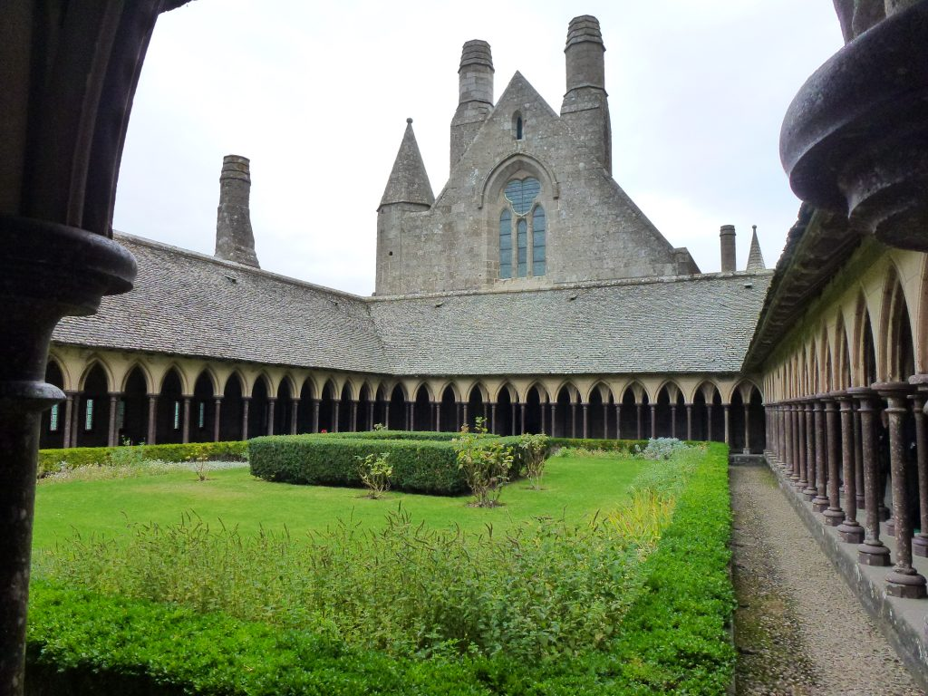 The Abbey Cloisters are a tranquil retreat with stark stonework of the rest of the building