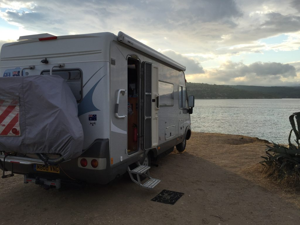 Pre-dust Storm photo of the Hymer at Agios Lionnos.  We I looked out in the morning I thought the black mat outside had blown away but it was buried in sand.