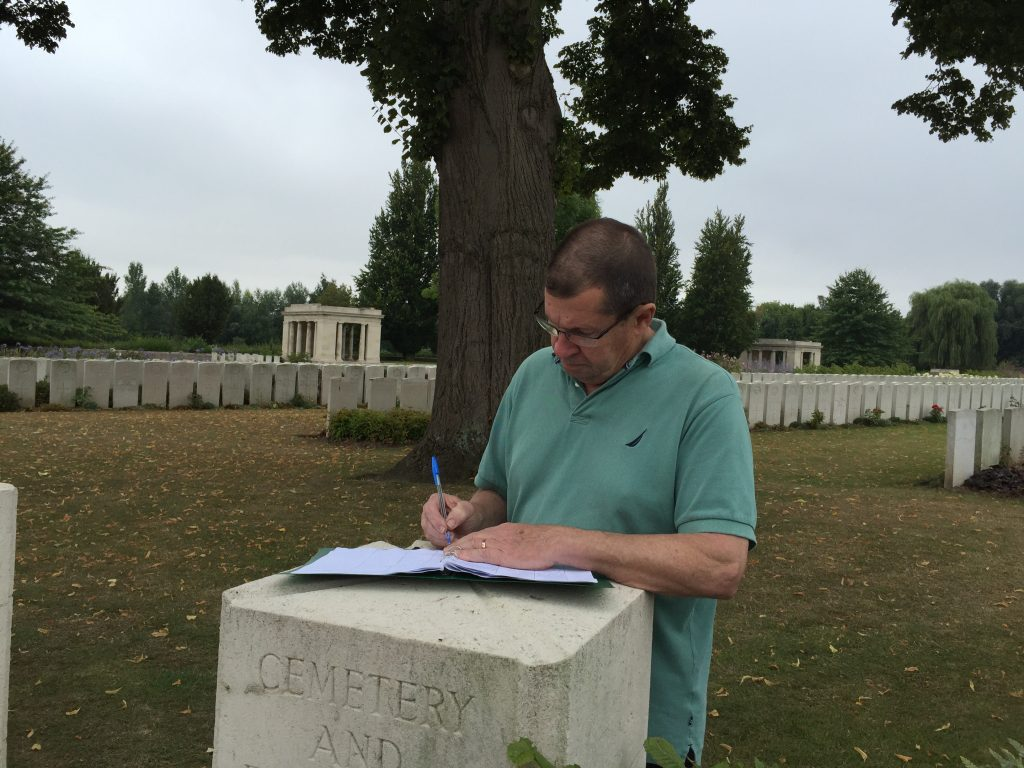 Signing the visitors book at Baileul