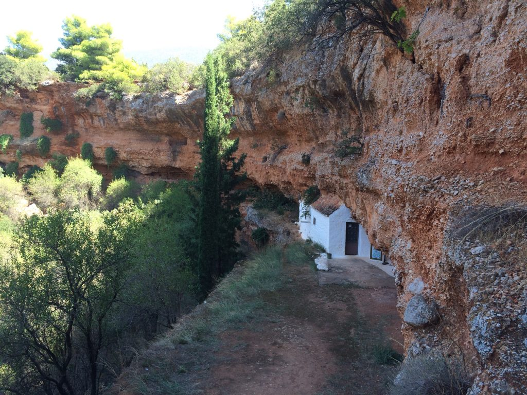 The locals have dug a shaft down through the rock into the sink hole. Steps are cut into the rock, the walls are white washed but it's still a little challenging. The end is worth the wait with this lovely little chapel constructed into the cave.
