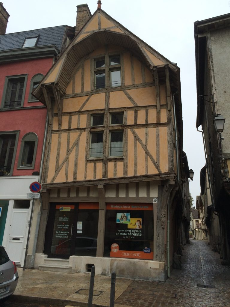 Typical Troyes streetscape of old half timber building and narrow lanes.