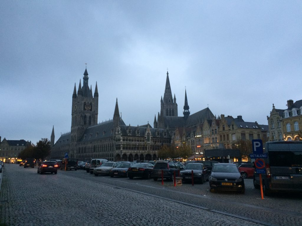 Late afternoon in Ypres, across the square. The Cloths Hall and Cathedral in the background.