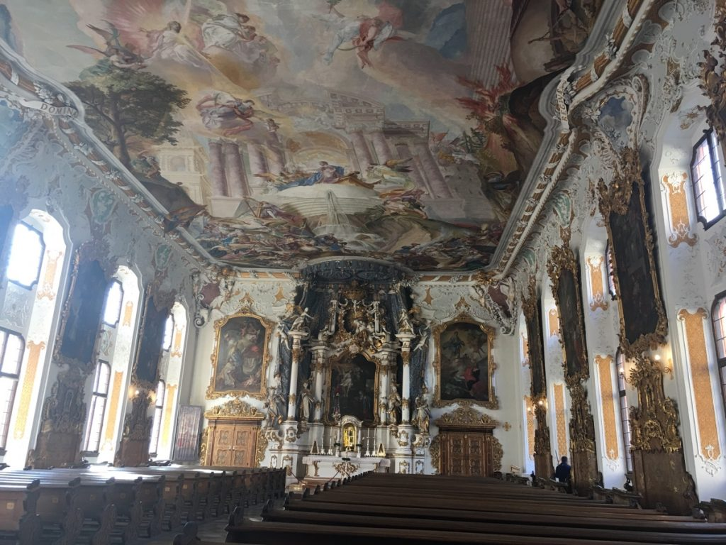 Apparently its interior is considered a jewel of Baroque architecture. It has a phenomenal fresco painted on its flat ceiling, the ornate cornise and the timber work adds to the wow factor.